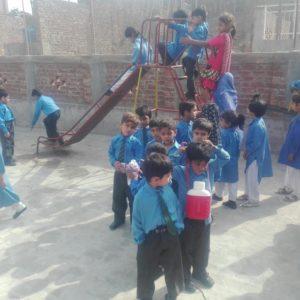 Children at play Roof top play area Basti Saidan Shah