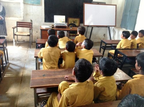 video lessons in village classrooms on laptops